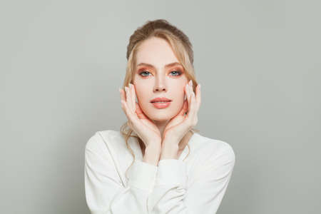 Healthy woman with clear skin. Facial treatment and skincare concept