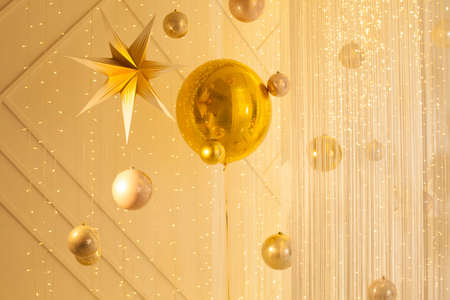 Beautiful golden background with bokeh light and gold star decorations