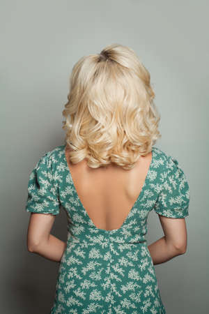 Beautiful blonde woman back with perfect curly long bob haircut