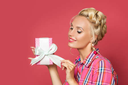 Retro woman with gift on red