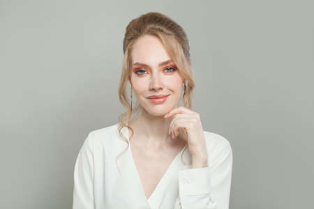 Smiling woman with healthy clear skin. Facial treatment and skincare concept