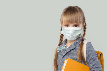 Pretty child girl in medical protective face mask on white background Stock fotó