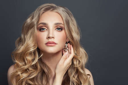 Beautiful blonde woman with jewelry diamond earring, fashion portrait