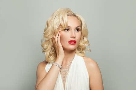 Beautiful blonde woman in gold jewelry with diamonds, fashion portrait Reklamní fotografie