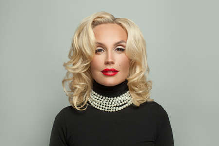 Stylish mature woman model with curly hairstyle and makeup