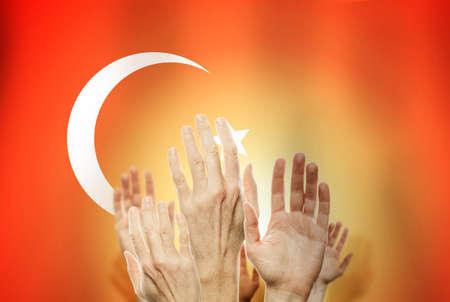 People hands against Turkey flag background Stock fotó