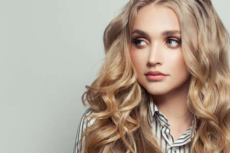 Perfect woman with long curly blonde hairstyle on white Standard-Bild