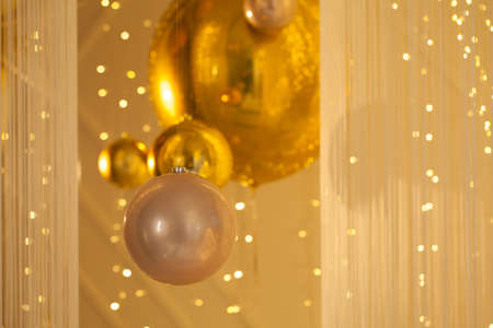 Golden background with baubles and bokeh light glowing sparkle 版權商用圖片