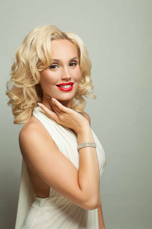 Celebrity blonde woman in diamond jewelry, fashion portrait