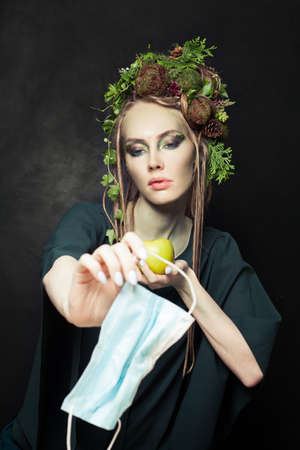 Waste during COVID-19. Earth woman with single-use face mask. Environment protection concept