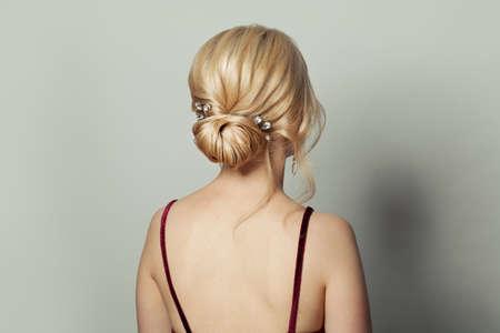 Beautiful female back head with bridal hairdo on white