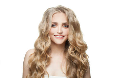 Happy blonde woman with long healthy curly hair isolated on white background