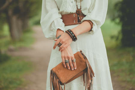 Brown handbag in the hands of a woman