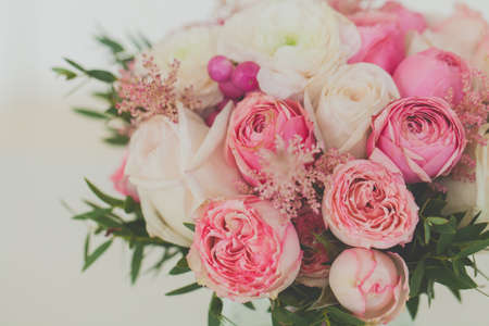 Roses and ranunculus flowers bouquet close up