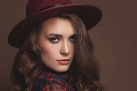 Beautiful woman in fedora hat portrait
