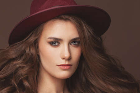 Lovely woman in red fedora hat portrait 写真素材