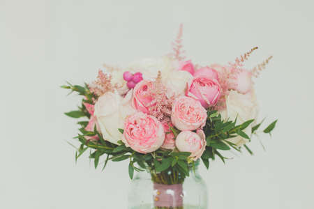 Gentle pink and white roses on white background