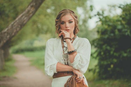 Bohemian style woman, fashion portrait outdoors