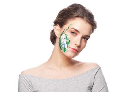 Cute woman with painted spring flowers on her face isolated on white background