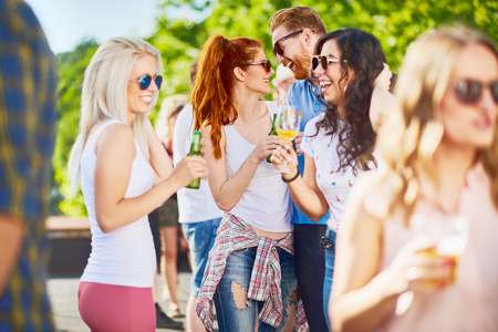 Couple hugging and flirting at outdoor party