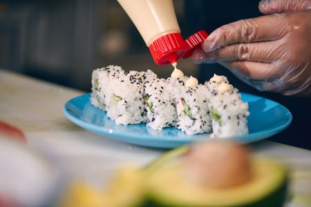 Chef making sushi Stock Photo