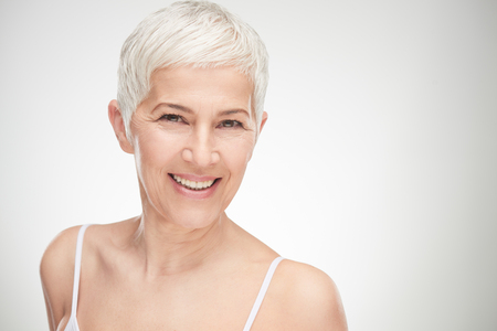 Portrait of beautiful senior woman in front of white background. Banco de Imagens - 95862115