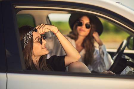 Two young women having fun on road trip