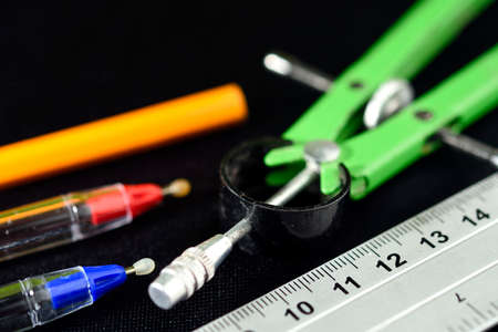 Materials for school use in mathematics, pencils, pencil, compass and a ruler all already used