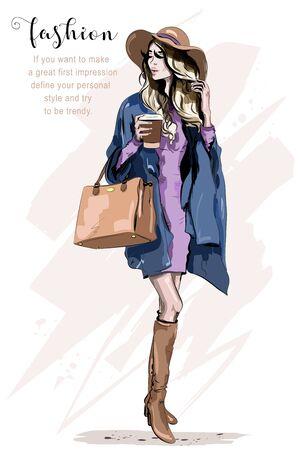 Belle jeune femme au chapeau. Femme élégante en vêtements de mode. Dame de la mode. Tenue d'automne. Fille dessinée à la main tenant une tasse de café. Esquisser.