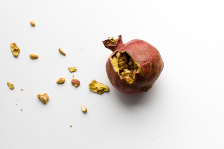 dried pomegranate on a white background, isolated