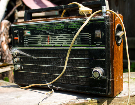 Close up of an old radio.The old radio receiver with a web