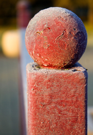 Part of a red fence, close up
