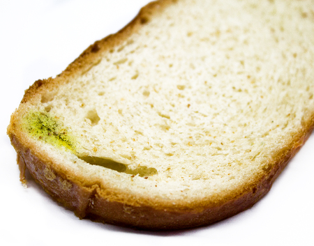 Stale white loaf, is isolated, for a background.Fungus on bread close-up shot,Food safety concept.