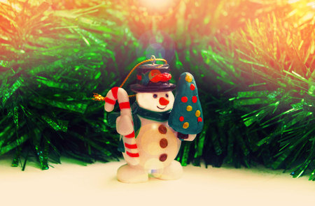 onset: Snowman with fir. The onset of the New Year and Christmas.Christmas background with Christmas tree and snowman