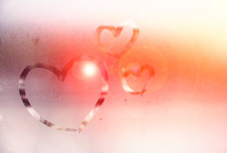 The inscription on the sweaty glass - love and heart. St. Valentines Day. Effect of a tonality soft light