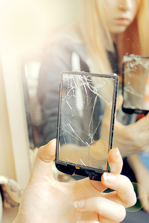 nosering: the girl looks through a broken glass, Soft light effect Stock Photo