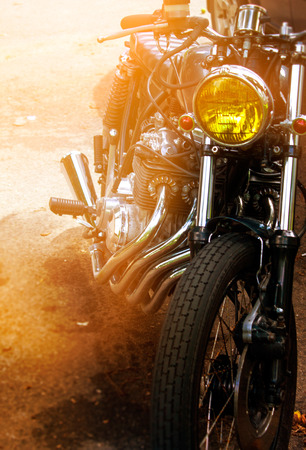 tense: Part of a motorcycle close-up in the sun