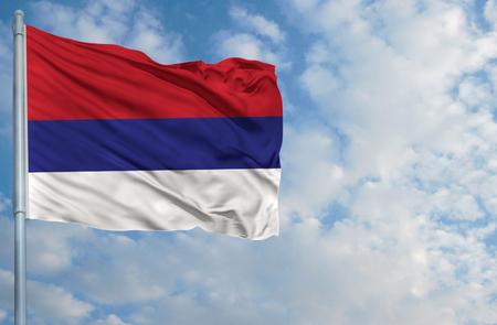 republika: National flag of Republika Srpska on a flagpole in front of blue sky.