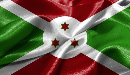 Realistic flag of Burundi on the wavy surface of fabric. This flag can be used in design