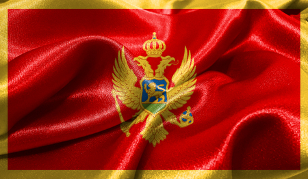 Realistic flag of Montenegro on the wavy surface of fabric. This flag can be used in design Stock Photo