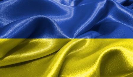 ファブリックの波状の表面でウクライナの現実的なフラグは。デザインでこのフラグを使用することができます。