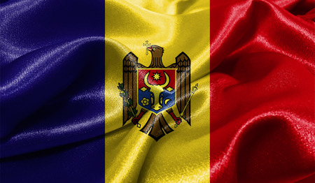 Realistic flag of Moldova on the wavy surface of fabric. This flag can be used in design