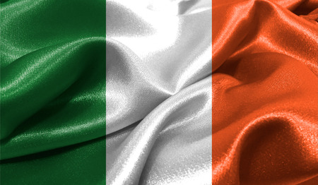 british culture: Realistic flag of Ireland on the wavy surface of fabric. This flag can be used in design