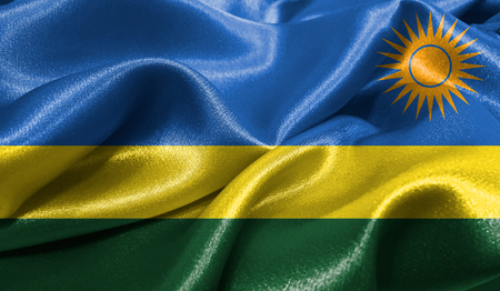 Realistic flag of Rwanda on the wavy surface of fabric. This flag can be used in design