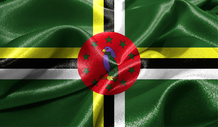 Realistic flag of Dominica on the wavy surface of fabric. This flag can be used in design