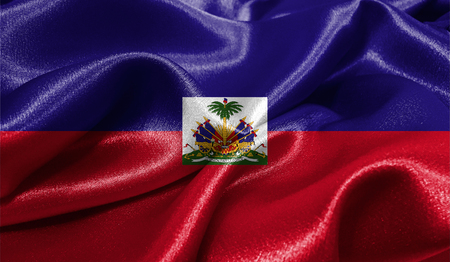 ファブリックの波状の表面でハイチの現実的なフラグは。デザインでこのフラグを使用することができます。