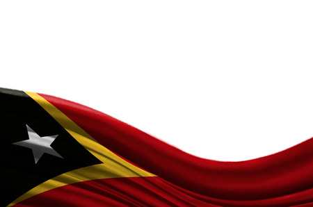 Grunge colorful flag East Timor with copyspace for your text or images,isolated on white background. Close up, fluttering downwind.