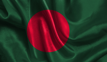 Realistic flag of Bangladesh on the wavy surface of fabric. This flag can be used in design.