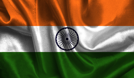 Realistic flag of India on the wavy surface of fabric. This flag can be used in design.