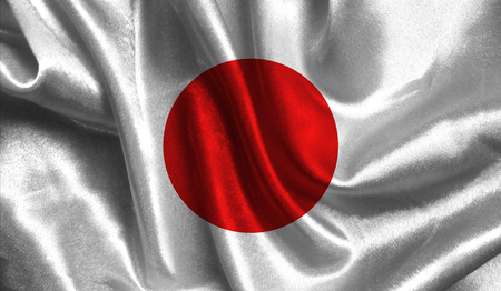 Realistic flag of Japan on the wavy surface of fabric. This flag can be used in design.